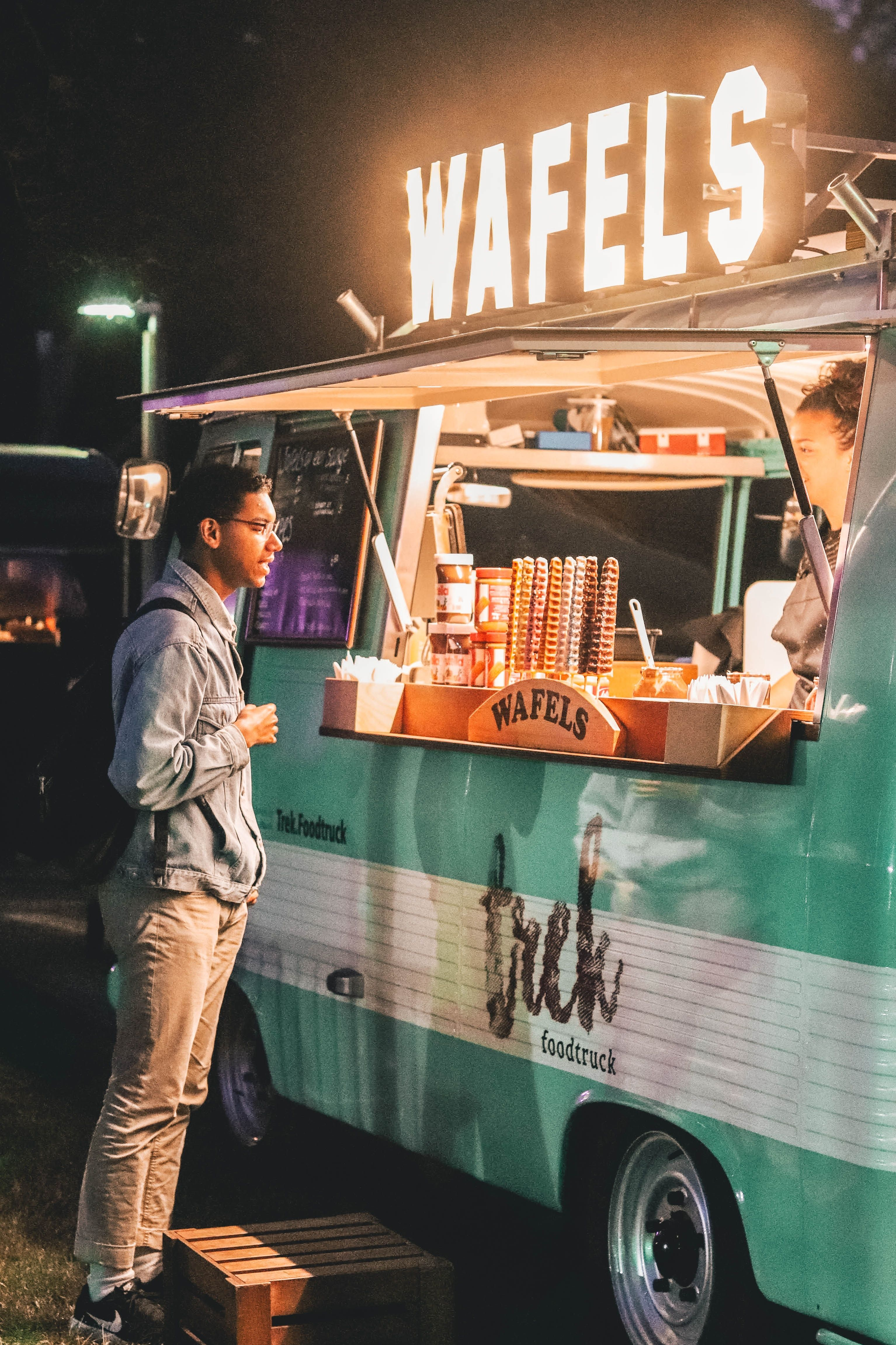 Man in front of a food truck